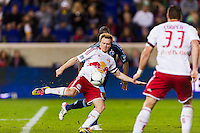 Dax McCarty (11) of the New York Red Bulls takes a shot. The New York Red Bulls and Sporting Kansas City played to a 0-0 tie during a Major League Soccer (MLS) match at Red Bull Arena in Harrison, NJ, on October 20, 2012.