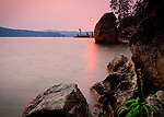 Idaho, Northern, Kootenai County, Coeur d'Alene. Smoky skies cast a pink glow over Lake Coeur d'Alene in the evening from Tubbs Hill.