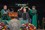 OHIO alum Cheryl Hurley (Center Right) , President & Chief Executive Officer of the Library of America recieves an honorary degree at graduate commencement. Photo by Ben Siegel