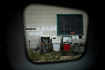 Travel scenes of Wyoming through the window of a rented Mazda M5...Gas Station in Jeffery City, a ghost town left empty by the closure of a Uranium mine in the mid 80s.