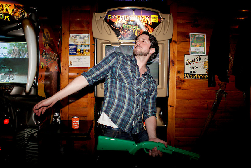 Reigning Big Buck world champion Alex DerHohannesian, 30, poses for a portrait at The Black Bear Lodge in Manhattan, which hosted an official Big Buck Party on Thursday April, 28, 2011. Fans of the popular hunting arcade game were invited to test their skill against other Big Buck Hunter fans to compete for prizes, enter to win raffle merchandise and meet Big Buck Girls...Danny Ghitis for The New York Times