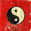 Black and white Yin and Yang on red with ancient asian calligraphy.