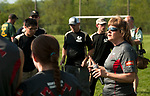 BEACON FALLS,  CT-051917JS10- Shannon Strong, who started the Wamogo Timber Team, gives instructions to participants from Wamogo and Woodland at their first ever Axe Games Friday at Woodland Regional High School in Beacon Falls.<br />  Jim Shannon Republican-American