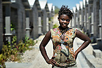"""Ketia Pajeotle, 14, stands amid houses in a model resettlement village constructed by the Lutheran World Federation in Gressier, Haiti. The settlement houses 150 families who were left homeless by the 2010 earthquake, and represents an intentional effort to """"build back better,"""" creating a sustainable and democratic community."""