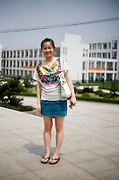 Wangchaojie, a student, age 24, poses for a portrait in Nanjing. Response to 'What does China mean to you?': 'A country.'  Response to 'What is your role in China's future?': 'To be a good teacher.'