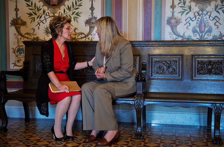 UNITED STATES - JUNE 12:  Sen. Barbara Boxer, D-Calif., left, talks with Cally Houck, before a news conference in the Capitol, whose daughters Raechel, 24, and Jacqueline, 20, were killed in 2004 crash in a rented PT Cruiser that was under a safety recall.  The pair, along with Sen. Chuck Schumer, D-N.Y., are calling for car rental companies to pledge not to rent or sell any vehicles  that under safety recall until the problem has been fixed.  (Photo By Tom Williams/CQ Roll Call)