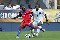 Fabrice Noel (11) controls the ball ahead of Osman Chavez (2). Honduras defeated Haiti 1-0 during the First Round of the 2009 CONCACAF Gold Cup at Qwest Field in Seattle, Washington on July 4, 2009.