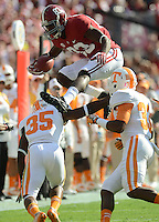 Photo by Gary Cosby Jr.   Alabama wide receiver Kevin Norwood leaps over Tennessee defensive back JaRon Toney and Tennessee defensive back LaDarrell McNeil as he runs after making a catch on a pass during the first half of the Alabama-Tennessee game Saturday in Tuscaloosa.