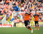 Dundee United v St Johnstone...27.09.14  SPFL<br /> Simon Lappin clears from Paul Paton<br /> Picture by Graeme Hart.<br /> Copyright Perthshire Picture Agency<br /> Tel: 01738 623350  Mobile: 07990 594431