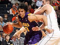 Jan. 2, 2011; Charlottesville, VA, USA; LSU Tigers forward Garrett Green (3) drives past Virginia Cavaliers forward Will Regan (4) during the game at the John Paul Jones Arena. Mandatory Credit: Andrew Shurtleff-