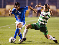 Cruz Azul forward Cesar Delgado (L) fights for the ball with Laguna Santos defender Rogelio Lopez during their soccer match at the Blue Stadium in Mexico City, March 15, 2006. Cruz Azul won 4-1 to Laguna Santos. © Photo by Javier Rodriguez/