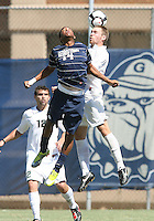 Chandler Diggs #14 of Georgetown University goes up for aheader against Kevin Cope #3 of Michigan State during an NCAA match at North Kehoe Field, Georgetown University on September 5 2010 in Washington D.C. Georgetown won 4-0.