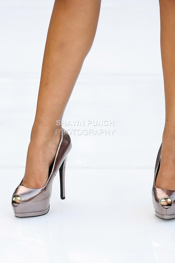 Model walks runway in a shoes by Pam John and Teri Ryan for the Silver Mosquito swimsuit fashion show, during the JRG Bikini Under The Bridge 2012 fashion show on July 9, 2012.