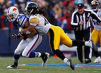 ORCHARD PARK, NY - NOVEMBER 28:  Troy Polamalu #43 of the Pittsburgh Steelers tackles David Nelson #86 of the Buffalo Bills during the game on November 28, 2010 at Ralph Wilson Stadium in Orchard Park, New York.  (Photo by Jared Wickerham/Getty Images)