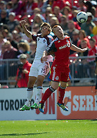 17 September 2011: Colorado Rapids midfielder Wells Thompson #15 and Toronto FC defender Richard Eckersley #27 in action during a game between the Colorado Rapids and Toronto FC at BMO Field in Toronto..Toronto FC won 2-1.