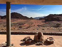 23. &quot;Timna, the 'Copper Kingdom,' with ancient vessels, an &quot;X&quot; and tiny figures in the distance&quot;:  Negev Desert.<br /> <br /> Timna is one of Israel's more than 60 national parks and nature reserves, an amazing number of sites for a country no bigger than New Jersey!<br /> <br /> At Timna, copper was mined more than 6,000 years ago, and continued to be mined periodically through the early Middle Ages.<br /> <br /> But for me, what's special about this image is the pairing of past and present. From the modern architecture of the visitor center, we see a desert without end, marked by an &quot;X&quot; from contrails that create the illusion that planes have been flying on a crash collision course (just as Arabs and Jews may seem to be today). Broken clay vessels are chained to the concrete, and the tiny figures of the park's visitors traverse the ancient sands.