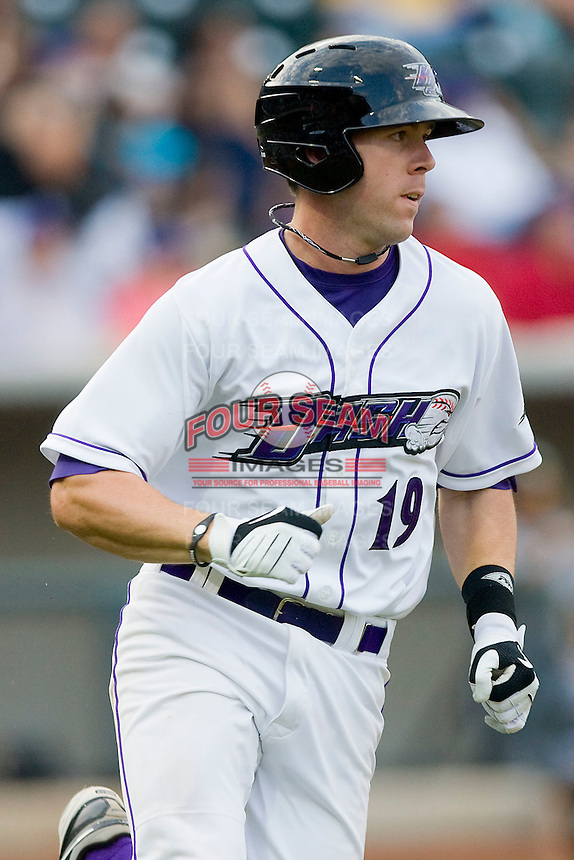 Jason Bour #19 of the Winston-Salem Dash hustles down the first base line against the Lynchburg Hillcats at  BB&T Ballpark May 22, 2010, in Winston-Salem, North Carolina.  Photo by Brian Westerholt / Four Seam Images