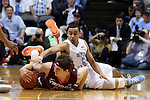18 January 2015: Virginia Tech's Will Johnston (left) and North Carolina's Marcus Paige (right) challenge for a loose ball. The University of North Carolina Tar Heels played the Virginia Tech University Hokies in an NCAA Division I Men's basketball game at the Dean E. Smith Center in Chapel Hill, North Carolina. UNC won the game 68-53.