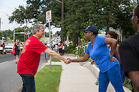 AUSTIN, TEXAS - Austin Mayor, Steve Adler shakes the hand of a parade attendee during the 2016 Central Texas Juneteenth Celebration Parade on Sat. June 18, 2016. <br /> <br /> The parade kicked off a daylong festival and celebration. Juneteenth is the oldest nationally celebrated commemoration of the ending of slavery in the United States. From its Texas origin in 1865, June 19th is observed as the African American Emancipation Day. June 19, 1865 is the day slaves in Galveston, Texas received news that President Lincoln had signed the Emancipation Proclamation two years earlier on January 1, 1863.<br /> <br /> Use of this image in advertising or for promotional purposes is prohibited.<br /> <br /> Editorial Credit: Dan Herron / Herronstock Editorial.