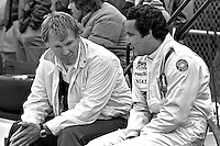 INDIANAPOLIS, IN - MAY 27: Dan Gurney (left) and Danny Ongais converse before practice for the Indy 500 at the Indianapolis Motor Speedway in Indianapolis, Indiana, on May 27, 1979.