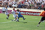 Abby Wambach (28) scores the sudden-death championship winning golden goal past Kylie Bivens (4) and Briana Scurry (1) while Mia Hamm (9) watches at Torero Stadium in San Diego, CA on 8/24/03 ending the WUSA's Founders Cup III between the Atlanta Beat and Washington Freedom. The Freedom won 2-1 in overtime on this shot.