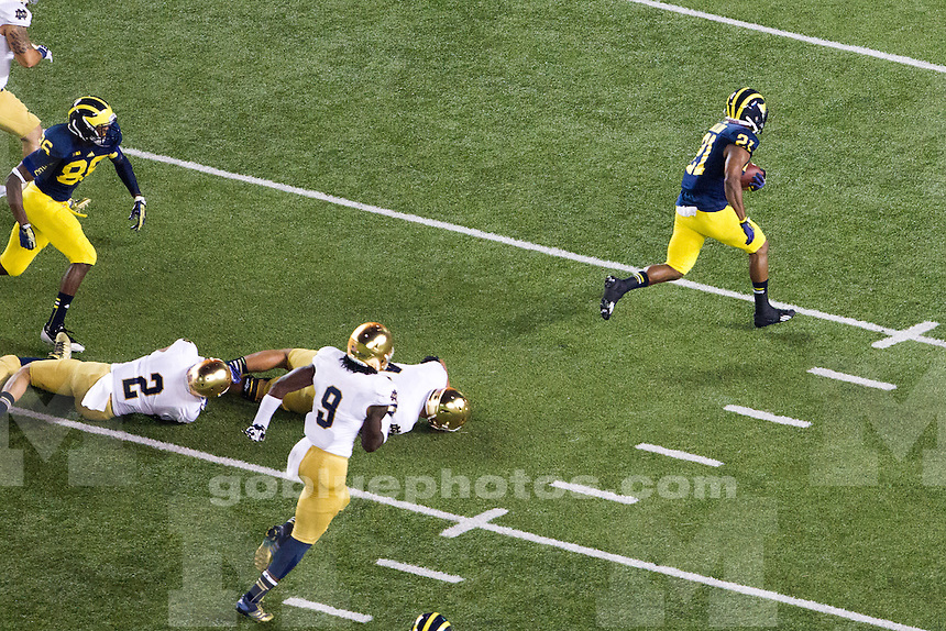 The University of Michigan defeats Notre Dame, 41-30, at Michigan Stadium during 'Under the Lights II' on September 7, 2013 in Ann Arbor, Michigan.