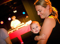 6 months-old Ben attends his first Baby Loves Disco event with his mum at Southpaw nightclub in the Park Slope neighborhood of Brooklyn in New York City, USA, 6 October 2007. In two years, Baby Loves Disco, a midday soiree specifically for the Mommy-and-me set, has become a nationwide phenomenon. One afternoon each month, local organizers take over a nightclub, complete with a cash bar and DJ and throw open the doors to anyone under the age of 7, accompanied by parents.