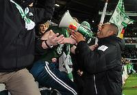 FUSSBALL   1. BUNDESLIGA   SAISON 2011/2012    14. SPIELTAG SV Werder Bremen - VfB Stuttgart       27.11.2011 NALDO (Bremen) jubelt nach dem Abpfiff mit einen Megaphon in der Ostkurve mit den Fans