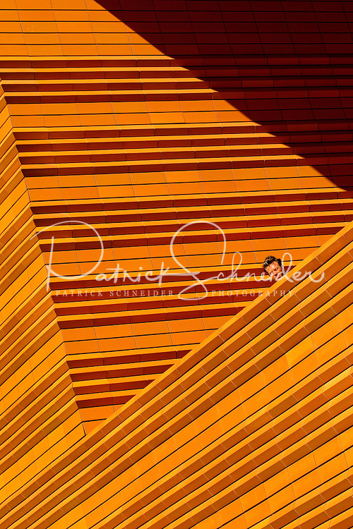 A visitor to downtown Charlotte peers over the edge of a building to watch the action down below during the Wells Fargo Community Celebration, held October 29, 2011 in downtown Charlotte NC. The daylong festival took place in the streets, in public atriums and in downtown museums, which offered free admission all day long. Wells Fargo, which this month completed its conversion from Wachovia, picked up the bill.