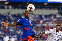 Haiti midfielder Yves Hadley Desmarets (15) and Honduras defender Brayan Beckeles (3) Honduras defeated Haiti 2-0 during a CONCACAF Gold Cup group B match at Red Bull Arena in Harrison, NJ, on July 8, 2013.