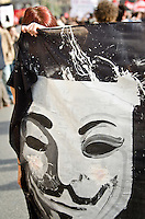 ITA: Un manifesto con dipinto la maschera di Guy Fawkes, Roma 19 Ottobre 2013. Decine di migliaia di persone sono scese in piazza per protestare contro le misure di austerit&agrave; e tagli di bilancio in Italia. (Foto di Adamo Di Loreto/BuenaVista*photo) ENG: <br /> A poster with the painted mask of Guy Fawkes on October 19, 2013 in Rome. Tens of thousands of people took to the streets to protest against the austerity measures and budget cuts in Italy. (Photo credit Adamo Di Loreto/BuenaVista*photo)