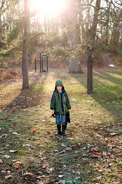 My older son emerges from the woods after a winter break hike.