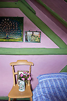 A cheeful effect is created by the pink walls and contrasting green woodwork in the second bedroom