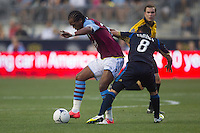Nathan Delfolineso of Aston Villa gets pushed from behind by Roger Torres of the Philadelphia Union during a match between Aston Villa FC and Philadelphia Union at PPL Park in Chester, Pennsylvania, USA on Wednesday July 18, 2012. (photo - Mat Boyle)