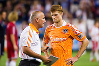 Houston Dynamo head coach Dominic Kinnear talks with Andre Hainault (31) after the match. The New York Red Bulls defeated the Houston Dynamo 2-0 during a Major League Soccer (MLS) match at Red Bull Arena in Harrison, NJ, on August 10, 2012.