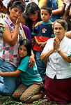 1/31/99 Al Diaz/Herald staff--Earthquake victims, Ana Rita Forero with daughter, Paola Andrea Villarreal Forero, 8, while praying with Alicia Echeveria Marti  during Catholic Mass at Bosque Park in Armenia, Colombia.<br />