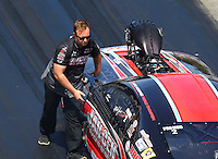 Jun 18, 2016; Bristol, TN, USA; Mike Janis Jr , crew member for NHRA pro mod driver Mike Janis during qualifying for the Thunder Valley Nationals at Bristol Dragway. Mandatory Credit: Mark J. Rebilas-USA TODAY Sports