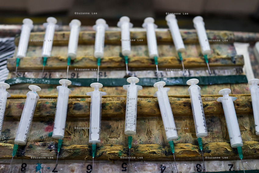 Syringes for color mixing samples are placed in an orderly row at the Pratibha vertically integrated garment unit in Indore, Madhya Pradesh, India on 11 November 2014. Photo by Suzanne Lee for Fairtrade