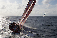 FRANCE,  Point Penmarc'h. 1st July 2012. Volvo Ocean Race, Leg 9 Lorient-Galway.  Camper with Emirates Team New Zealand with Team Telefonica in the distance.