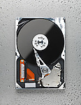 Open computer hard disk drive HDD on wet metal surface