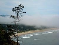 An overlook along highway 101 reveals the cloud covered beach town of Manzanita, Oregon, USA.