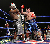 Danny Williams (silver shorts, Brixton) defeats John McDermott (blue shorts, Horndon) in a Heavyweight contest for the British Title at Goresbrook Leisure Centre, Dagenham, Essex promoted by Frank Maloney / FTM Sports - 18/07/08 - MANDATORY CREDIT: Gavin Ellis/TGSPHOTO - Self billing applies where appropriate - Tel: 0845 094 6026.
