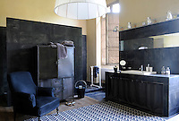 Different shades and textures of black in slate, velvet and steel are combined to stunning effect in this bathroom