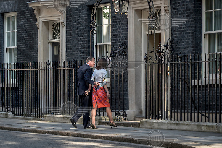 Prime Minister David Cameron, accompanied by his wife Samantha, goes back inside number 10 Downing Street, after making a statement to the media having lost the EU referendum vote.