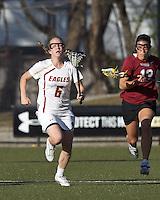 Boston College midfielder Sarah Mannelly (6) brings the ball forward.