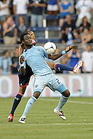 Kei Kamara (23) forward Sporting KC controls the ball..Sporting Kansas City and New England Revolution played to a 0-0 tie at LIVESTRONG Sporting Park, Kansas City, KS.