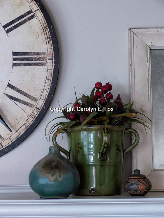 Decorative items add to the charm of the fireplace mantel.