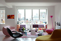 Karim Rashid's New York apartment is filled with colourful furniture and offers stunning views over Manhattan