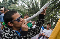A young man smokes marijuana on a street during celebrations of the International Day of the Marijuana and for the legalization in Medellin, Colombia, May 5, 2012. Photo by Fredy Amariles/VIEWpress.
