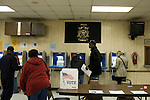 November 4, 2008. Durham, NC.. Voters flocked to the polls despite the rain that covered much of the state.. Here, at a VFW hall, officials had 112 ballots cast by 7:15 am even though approx. 50% of the precinct had voted early.